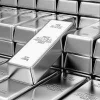 Stack of shiny silver bars inside a bank vault