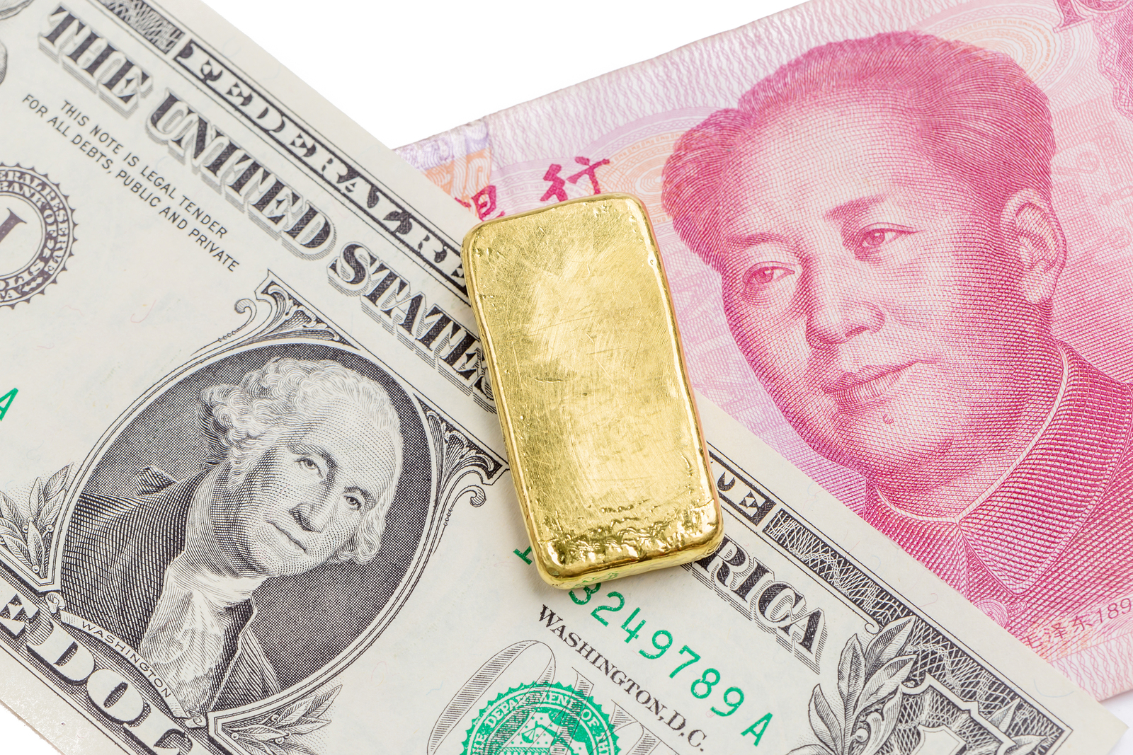 Dollar and Chinese banknote with gold bar
